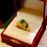 Gold ring with green emerald