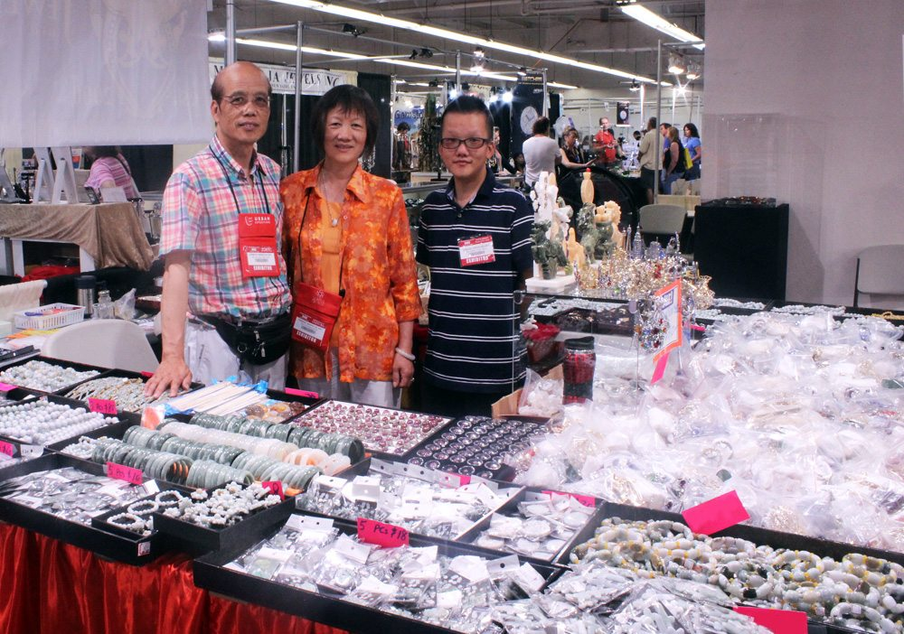 Ming and his family at their booth at the JOGS Gem & Jewelry Show